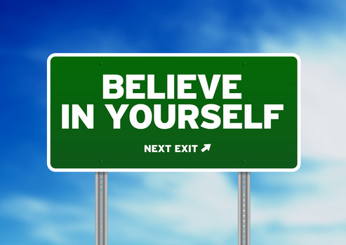 Green Believe in yourself highway sign on Cloud Background.